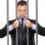 http://www.dreamstime.com/stock-photos-businessman-jail-holding-bars-image15803623