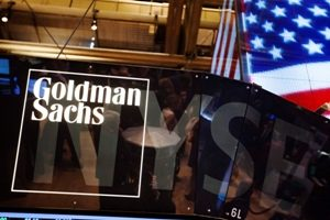 The Goldman Sachs logo is displayed on a post above the floor of the New York Stock Exchange, in this September 11, 2013 file photograph. Goldman Sachs Group Inc's quarterly profit fell 2 percent as weak bond-trading volumes hit revenue in the Wall Street bank's biggest business. The fifth-largest U.S. bank by assets reported on October 17, 2013 a third-quarter profit of $1.43 billion, or $2.88 per share. This compared with a profit of $1.46 billion, or $2.85 per share, a year earlier. REUTERS/Lucas Jackson/Files (UNITED STATES - Tags: BUSINESS LOGO)